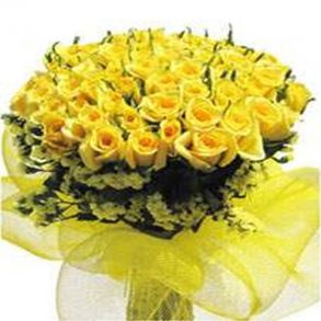 Yellow roses with green leaves wrapped in yellow transparent fabric
