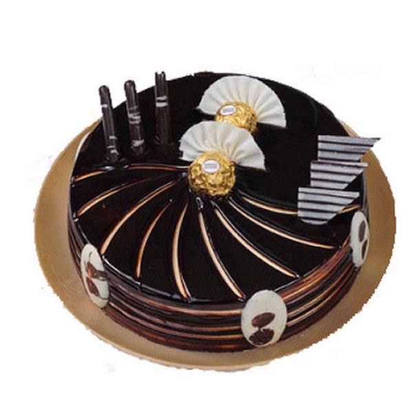 Round shaped chocolate cake with ferrero rocher chocolate on top