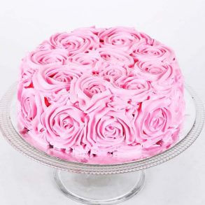 Round shaped chocolate cake decorated with pink roses design on top