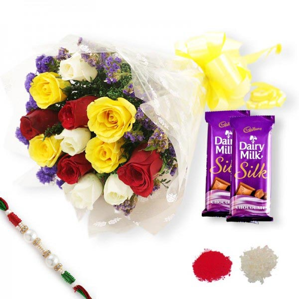 Colourful roses wrapped in cellophane with dairy milk chocolate and rakhi