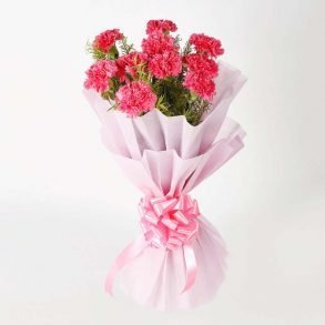 Pink carnations wrapped in pink paper and tied with pink ribbon