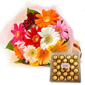 Mixed coloured gerberas wrapped in pink paper, and ferrero rocher chocolate box