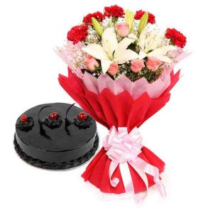 Pink roses, red carnation and withe lilies wrapped in red and pink paper, and chocolate truffle cake