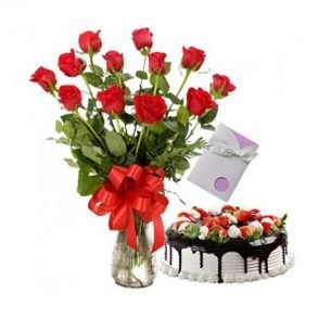 Red roses and round shaped cake with greeting card