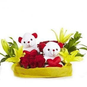 Basket of yellow lilies and red roses with two white teddies