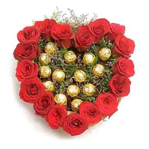 arrangement of 17 red roses with green leaves and 16 ferrero rocher chocolates in basket