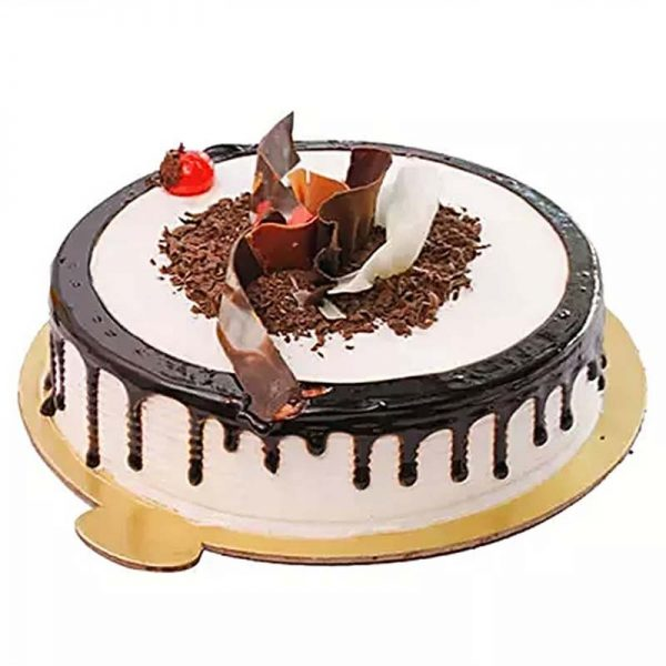 Round shaped black forest cake decorated with brown and white chocolate crust and cherry