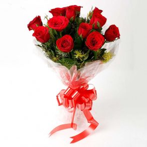 Red roses wrapped with cellophane