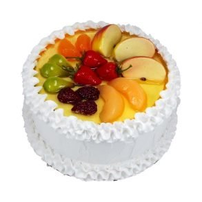 Round shaped fruit cake with fruits on top