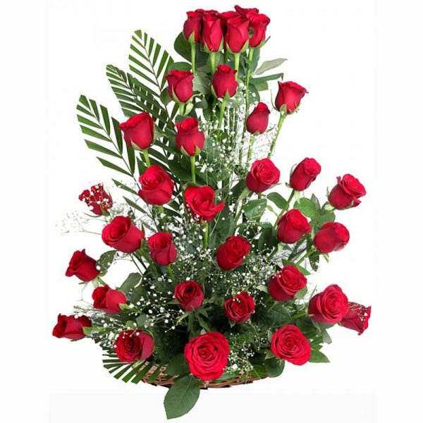basket arrangement of red roses decorated with green leaves
