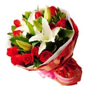 White lilies and red roses wrapped in white and red paper