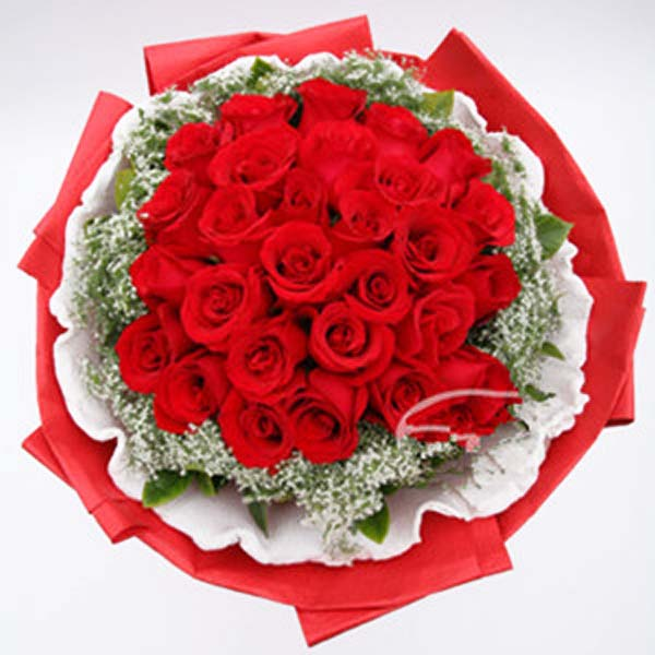 Red roses with green leaves wrapped in red and white paper