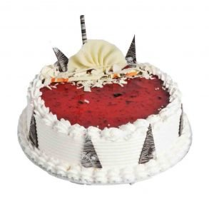 Round shaped strawberry cake with chocolate on top