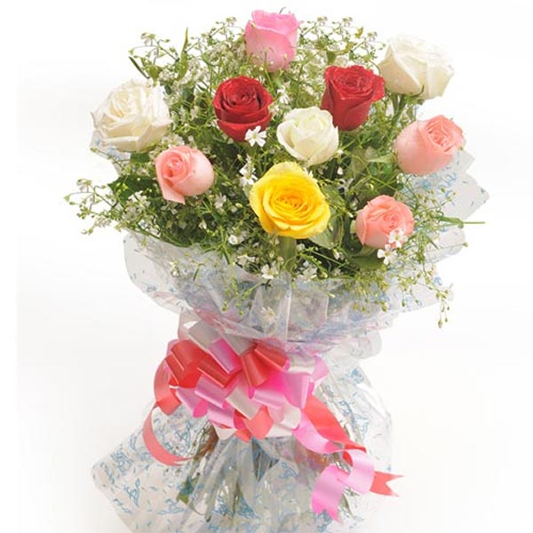 Mixed coloured roses with green leaves wrapped with cellophane and tied with pink ribbon