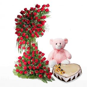 Red roses bouquet, and heart shaped cake with pink teddy