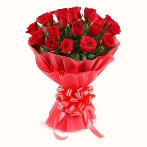 Red roses wrapped with red paper and tied with red ribbon