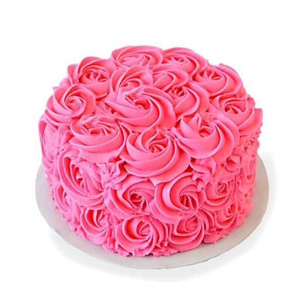 Round shaped pink coloured chocolate cake