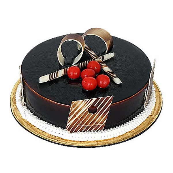Round shaped chocolate cake decorated with red cherries