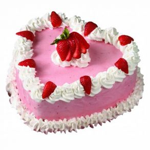 Heart shaped strawberry cake decorated with strawberry on top
