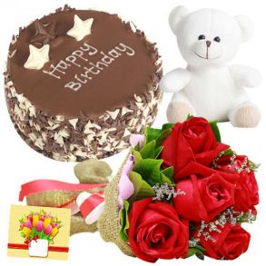 Red roses and chocolate cake with white teddy and greeting card