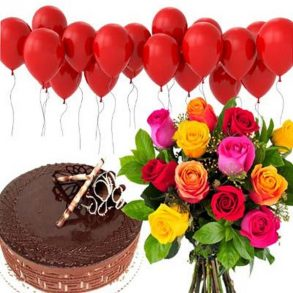Mixed roses and red balloon with round shaped chocolate cake