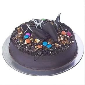 Round shaped chocolate cake decorated with gems, dark chocolates, and dryfruits