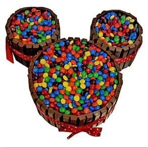 Mickey mouse design cake decorated with chocolate on side and colourful gems on top