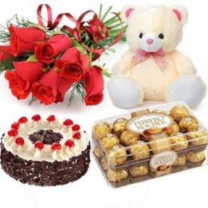 Combo of red roses, black forest cake, white teddy and ferrero rocher chocolate