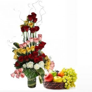 Colourful red roses, and fruit basket