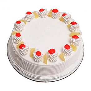 Round shape pineapple cake with pineapple pieces and red cherries