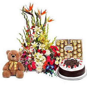 100 seasonal flowers with a round shaped black forest cake and 1 feet brown teddy with 300 gms ferrero rocher chcolate