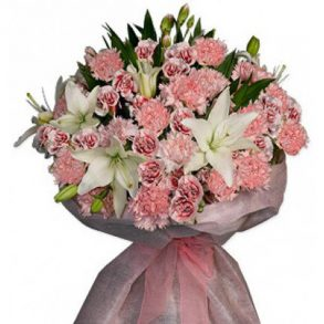 Pink carnation and white lilies wrapped in pink paper
