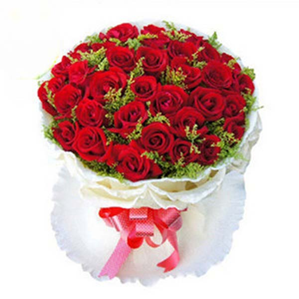 Red roses wrapped in white paper and tied with red ribbon