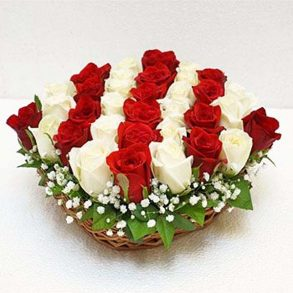 Red and white roses in basket