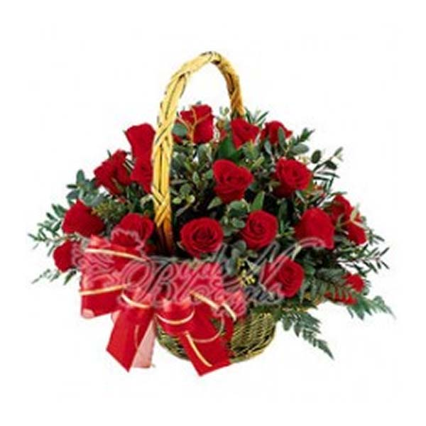 Handled basket of red roses and green leaves