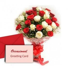 Red and white roses wrapped in cellophane with occasional greeting card