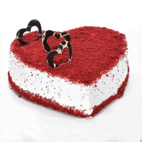 Heart shaped red velvet cake decorated with heart shaped chocoate ring on top