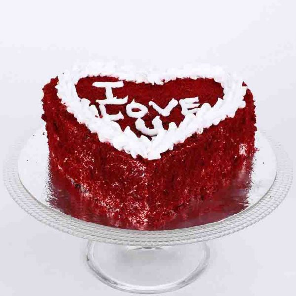 "Heart shaped red velvet cake says ""I Love You"" on its top"