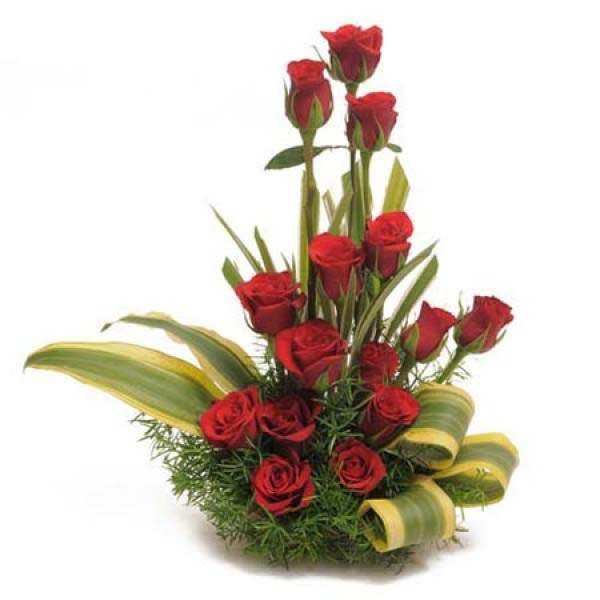 Basket of red roses and green leaves