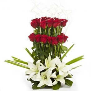 Red roses and white lilies beautified with green leaves