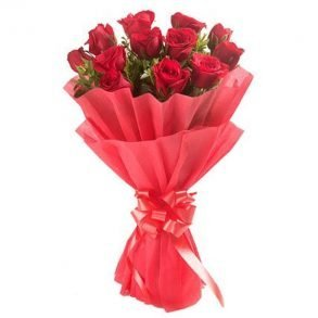 Red roses wrapped with red paper