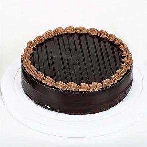 Round shaped chocolate truffle cake decorated with chocolate cream