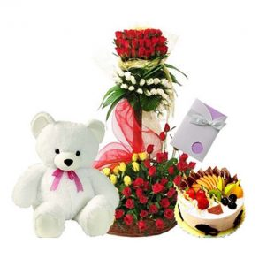 Red, white and yellow roses bouquet, with teddy, greeting card and round shaped fruit cake