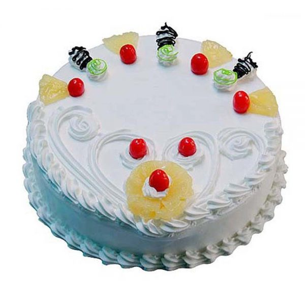 Round shaped pineapple cake with pineapple pieces and red cherries on top