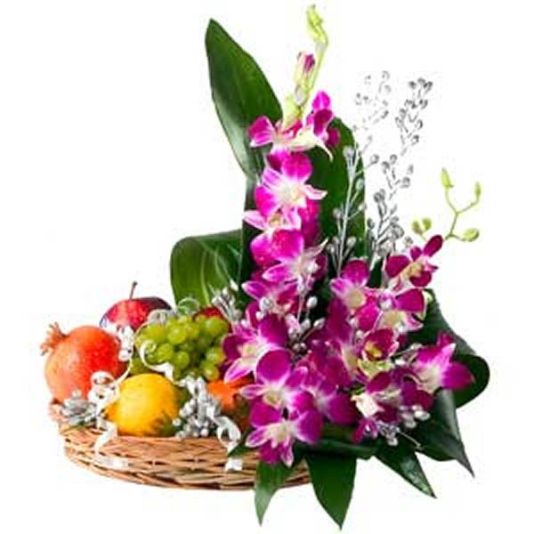 Basket of purple orchids and fruits decorated with green leaves