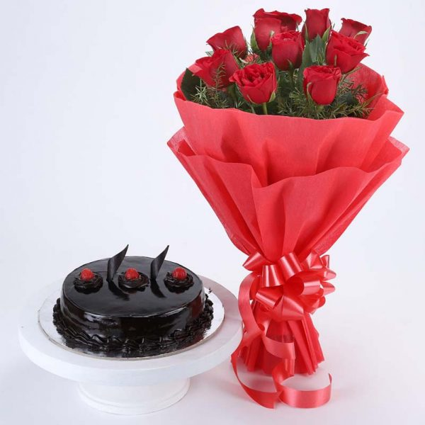 10 red roses with green leaves wrapped in red paper and tied with red ribbon and half kg chocolate truffle cake