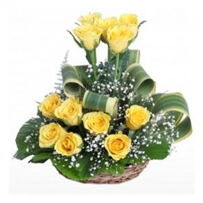 Basket of yellow roses and green leaves