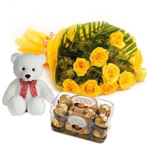 Yellow roses wrapped in yellow paper with ferrero rocher chocolate and small white teddy