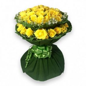 Two layered yellow roses bouquet wrapped in dark green paper and tied with green ribbon