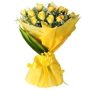 Yellow roses and green leaves wrapped with yellow paper and tied with yellow ribbon